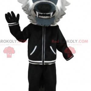 Graues Wolfsmaskottchen mit einer schwarzen Jacke. Wolfskostüm
