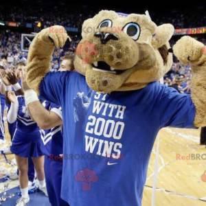 Beżowy tygrys maskotka w niebieskiej odzieży sportowej -