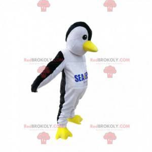 Mascotte del pinguino in bianco e nero con un becco giallo -