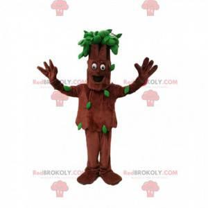 Mascota del árbol sonriendo con sus hojas verdes. Traje de