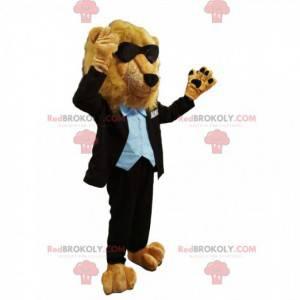 Maskot lva v černém kostýmu se slunečními brýlemi -