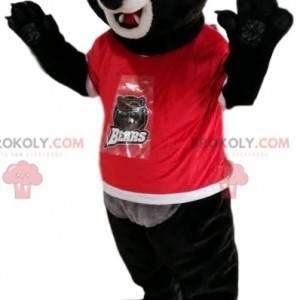Maskot černého medvěda v červeném dresu. Kostým černého medvěda