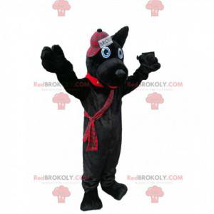 Schwarzes Hundemaskottchen mit einer schottischen Artkappe -