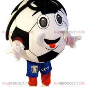 Uśmiechnięta maskotka piłki nożnej w niebieskie spodenki -