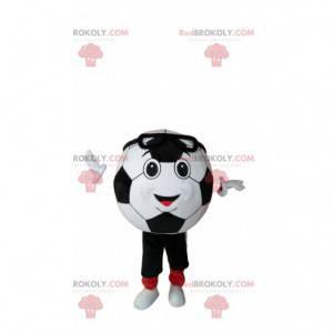 Uśmiechnięta maskotka piłki nożnej w odzieży sportowej -