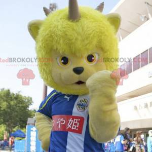 Yellow bear mascot of fantastic creature with horns -