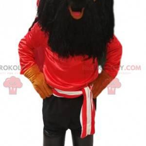 Pirátský maskot s červeným tričkem a dlouhým černým plnovousem