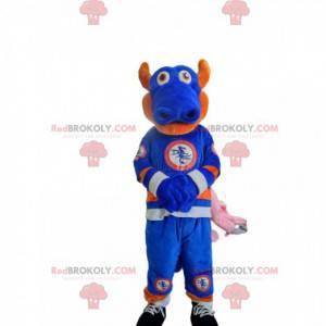 Mascote dragão azul e laranja em roupas esportivas. -