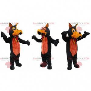 Mascota lobo negro y naranja con dientes grandes -