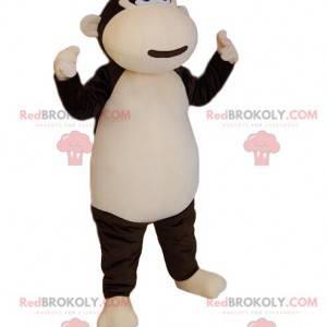 Mascota mono marrón y crema muy feliz. Disfraz de mono -