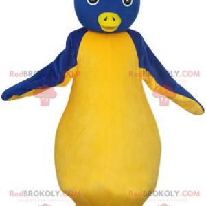 Mascote do pinguim azul e amarelo com olhos bonitos. -
