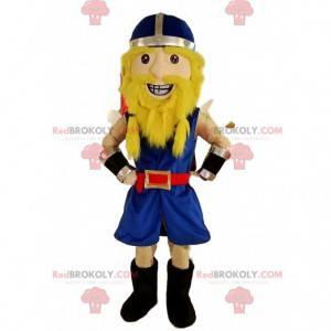 Mascota vikinga en traje azul tradicional, con su casco -