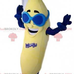 Veselý banánový maskot s modrými slunečními brýlemi -