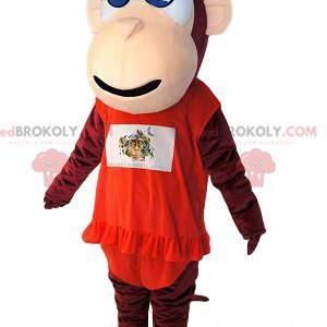 Macaco mascote marrom, com vestido vermelho com babado. -