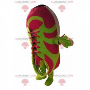 Fuchsie a zelený basketbalový maskot. Basketbalový oblek -