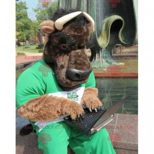 Brown bull mascot and black buffalo in green outfit -