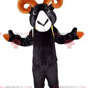 Mascota de íbice negro con hermosos cuernos marrones -