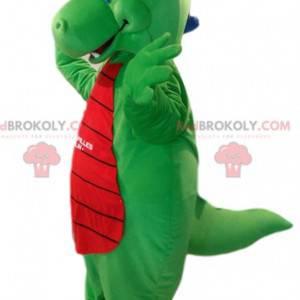 Mascote dragão verde e vermelho muito sorridente. Fantasia de