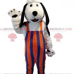 Hvit hundemaskot med oransje og blå stripete overall. -