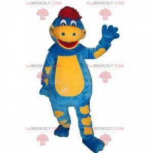 Mascote de dinossauro azul e amarelo com um puff vermelho -