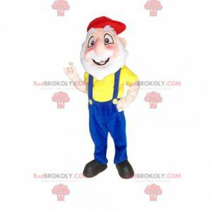 Vousatý muž maskot s modrým overalem a čepicí - Redbrokoly.com