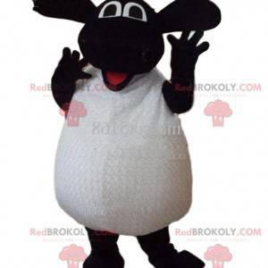 Mascotte di pecora bianca e nera molto entusiasta. -