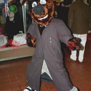 Braunes Hundemaskottchen mit einem langen grauen Mantel und