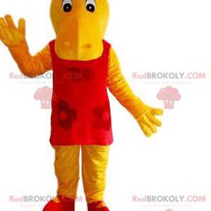 Mascota de hipopótamo amarillo con un vestido rojo -