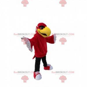 Mascot red eagle with a big yellow beak. Eagle costume -