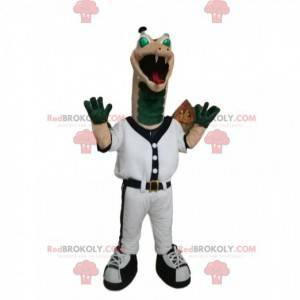 Mascotte rettile verde e beige in abbigliamento sportivo.