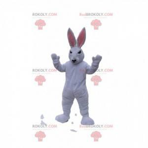 Hvit kaninmaskot med et stygt utseende. Bunny kostyme -