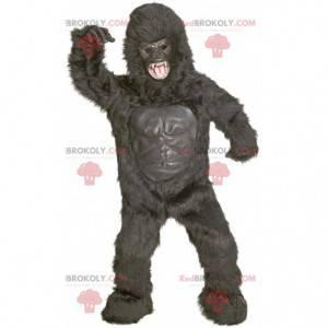 Mascote gigante gorila preto com aparência feroz -