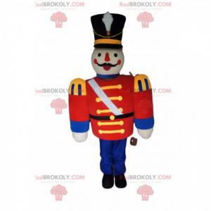 Mascotte soldato con una giacca rossa e un grande cappello nero