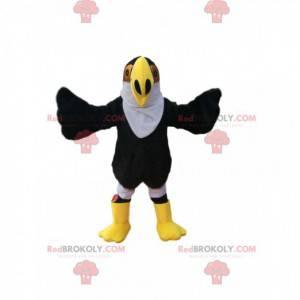 Maskottchen schwarzer Adler mit einem großen gelben Schnabel.