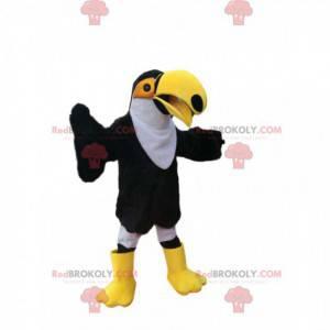 Maskottchen-Schwarzweiss-Tukan mit einem großen gelben Schnabel