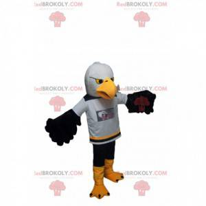 Golden eagle mascot with a supporter jersey. - Redbrokoly.com