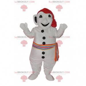 Hvit snømannmaskott med fargerikt skjerf og hatt -
