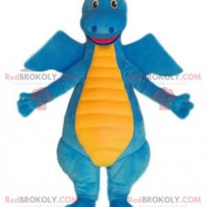 Mascote de dinossauro azul e amarelo muito sorridente. -