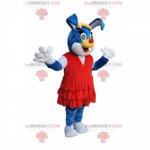 Blaues Kaninchenmaskottchen mit einem schönen roten Kleid -