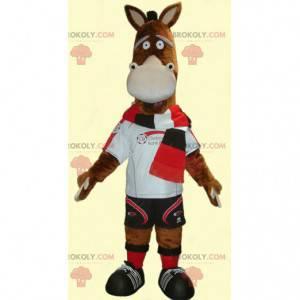 Maskottchen braunes Eselfohlen sehr lustig in Sportbekleidung -