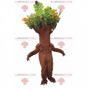 Bruine boom mascotte met groen blad - Redbrokoly.com
