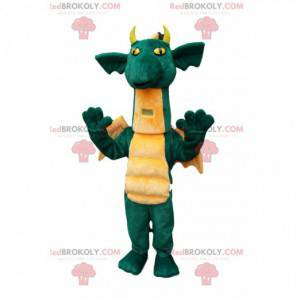 Comic grünes Drachenmaskottchen, mit hübschen gelben Flügeln -