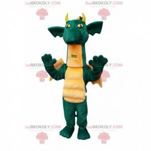Komiksově zelený drak maskot s pěkně žlutými křídly -