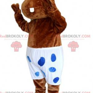 Mascot brown hyppopotamus with a white swimsuit with polka dots