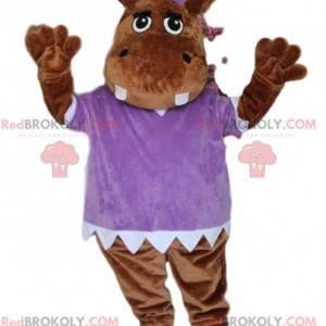 Mascotte ippopotamo marrone, con una camicetta viola -
