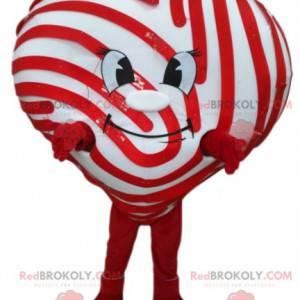 Weißes Herz Maskottchen lächelnd mit roten Streifen -