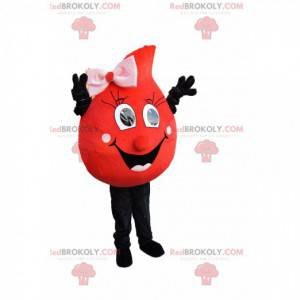 Red drop mascot with a wide smile and a pink bow -