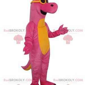 Mascote dinossauro rosa e amarelo com óculos de sol -