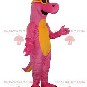 Rosa und gelbes Dinosauriermaskottchen mit Sonnenbrille -