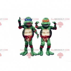 2 Maskottchen mit blauen und orangefarbenen Ninja Turtles -